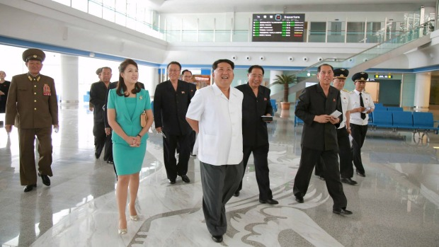 North Korean leader Kim Jong Un, centre, with his wife, gives field guidance at the new terminal of Pyongyang ...