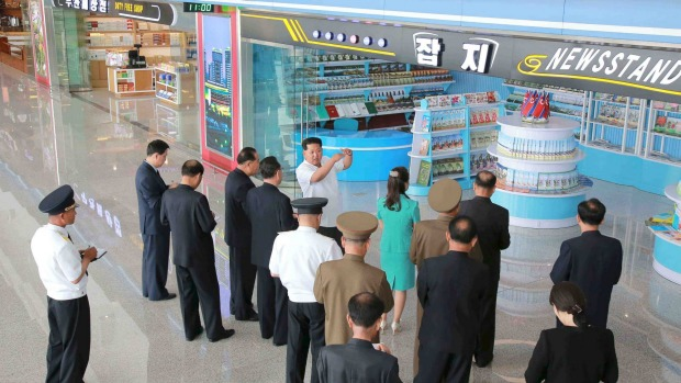 North Korean leader Kim Jong Un, centre, gives field guidance at the new terminal of Pyongyang International Airport in ...