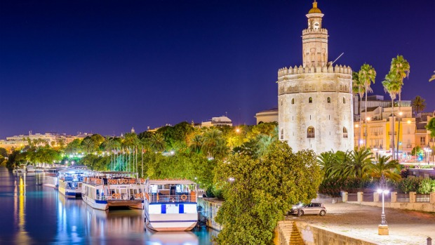 Seville, Spain at the Torre del Oro on the Guadalquivir River.