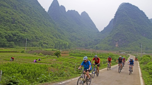 Cycling past limestone peaks near Xingping Yangshou.