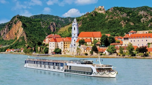 See Europe by river. Here, an APT ship cruises past Durnstein on the Austrian Danube.