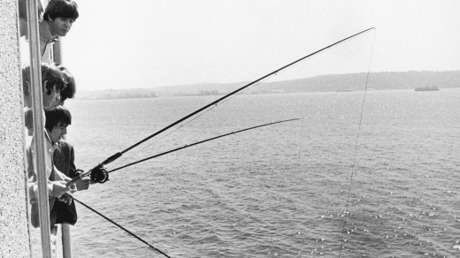 The Beatles do a spot of fishing from their hotel room in Seattle in August 1964.