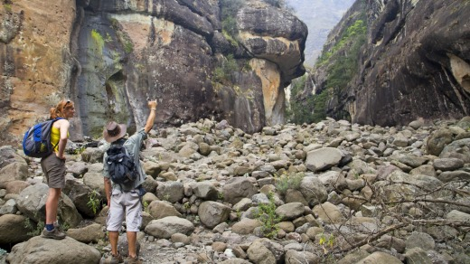 Hikers inside the Amphitheatre in South Africa's Drakensberg Mountains.
