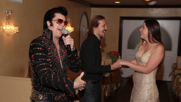 The author Shaney Hudson and hubby renew their vows to the sounds of Elvis.