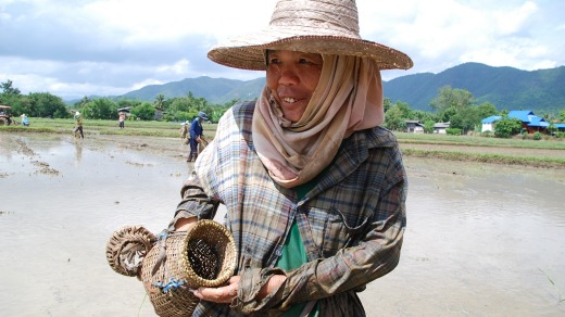 A woman shows her catch at Baan Mae.