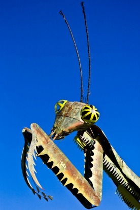 Downtown Container Park's Praying Mantis sculpture during the day.