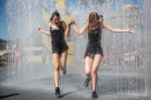 Cooling off in a fountain outside the Southbank Centre in London, England.
