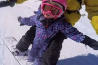 Kinsley tandem snowboarding with her dad.