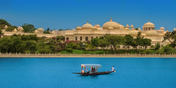 Hotel guests are met at the airport and taken by private car to a ferry that carries them across Lake Pichola to the ...