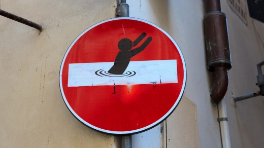 A road sign altered by street artist Clet Abraham.
