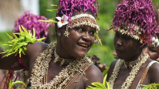 Villagers on Santa Ana Island perform  welcome dances for guests. Many have teeth dyed red through years of chewing ...