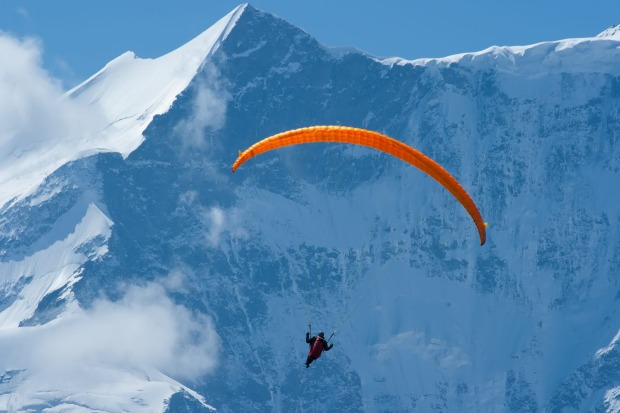 JUMPING OFF CLIFFS, SWITZERLAND. Tandem paragliding is about the best fun you can have trussed in a harness. Set it ...