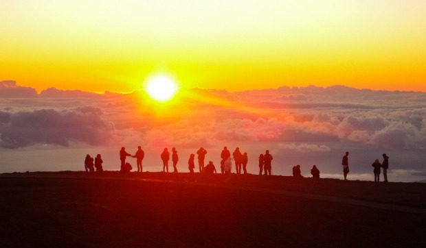 FREEWHEELING, MOUNT HALEAKALA, HAWAII USA. Downhill cycling on the swooping Mount Haleakala road is the ultimate ...