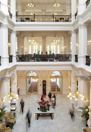 The colonial style lobby from the second floor walkway of the Raffles Hotel.