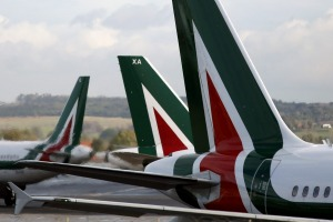 Logos sit on the tailfins of aircraft operated by Alitalia SpA, at Fiumicino airport in Rome, Italy, on Wednesday, Feb. ...