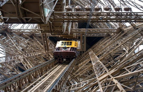 EIFFEL TOWER ELEVATOR  A miracle when they were installed, these elevators have been hauling visitors up through the ...