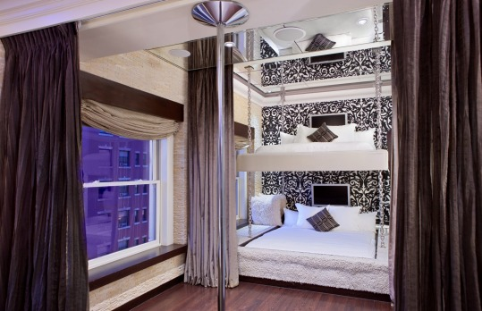 The Andaz San Diego's Andaz Star Suite has king size bunk beds, a mirrored ceiling, and a stripper pole.