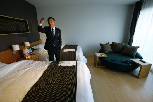 Huis Ten Bosch President Hideo Sawada speaks in a guestroom at the newly opened robot hotel, aptly called Henn na Hotel ...