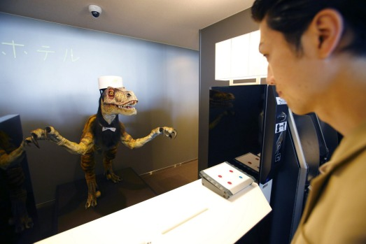 A receptionist dinosaur robot greets guests the new hotel, aptly called Henn na Hotel or Weird Hotel, in Sasebo, ...