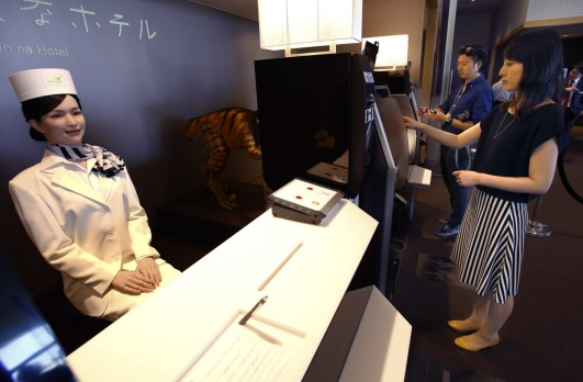 Huis Ten Bosch, a replica Dutch village now features a hotel staffed entirely by robots. A humanoid robot stands at the ...
