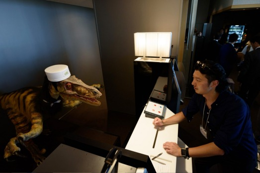 Receptionist robot greets guests as they check in at the new hotel, called Henn na Hotel or Weird Hotel, in Sasebo, ...