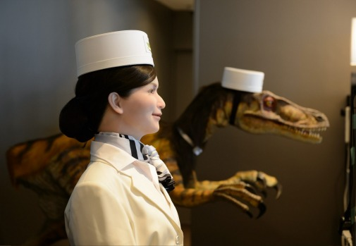 Huis Ten Bosch, a replica Dutch village now features a hotel staffed entirely by robots. A humanoid robot, left, and ...