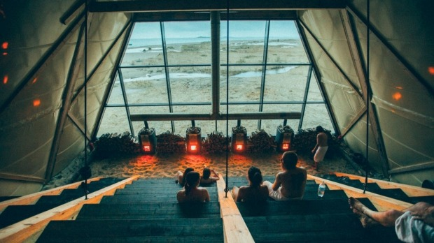 The glass-fronted sauna offers panoramic views over the Arctic Sea.