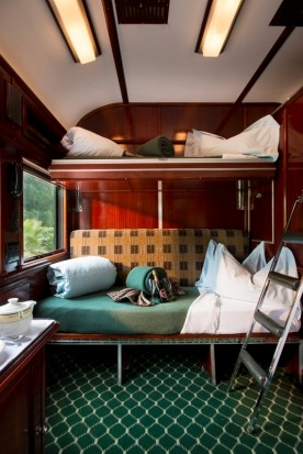 Throughout the train, the suites are fitted out in Rhodesian teak and pine, and the decorations are all very classy, ...