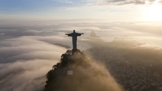 The statue of Christ the Redeemer stands like a guardian angel over the city.