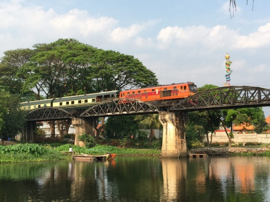 The Eastern & Oriental Express passing over the Bridge on the River Kwai.
