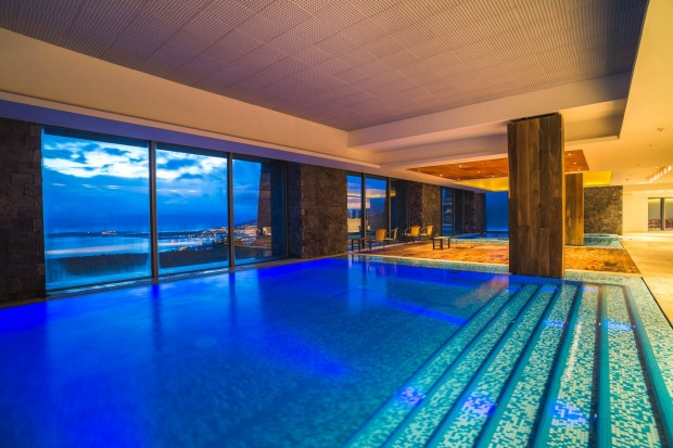 The indoor swimming pool at night.