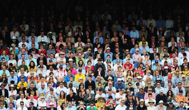 Spectators watch play at an Ashes Test Match between England and Australia at Lord's.