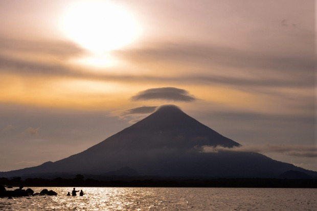 Concepcion volcano at sunset from Lake Nicaragua. Nicaragua has active volcanoes, massive lakes, cloud forests and ...