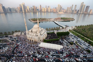 Muslims offer Eid al-Fitr prayers outside Al Noor Mosque in Sharjah, United Arab Emirates. The Muslim holiday Eid marks the end of 30 days of dawn-to-sunset fasting during the holy month of Ramadan.