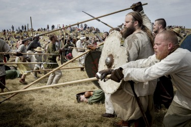 Around 200 people dressed as Vikings simulate a battle during the Viking Festival at Trelleborg, the Viking fortress of ...