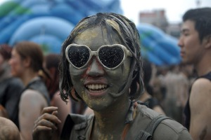 Festival-goers enjoy the mud during the annual Boryeong Mud Festival.