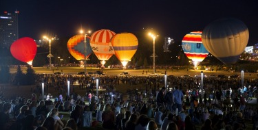 "People look at hot air balloons at the Cup Hot Air event during the Air Sports festival titled ""70 Years of Peaceful ..."