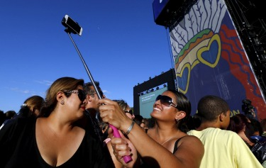 Revelers take a selfie during the Paleo Festival in Nyon, Switzerland.