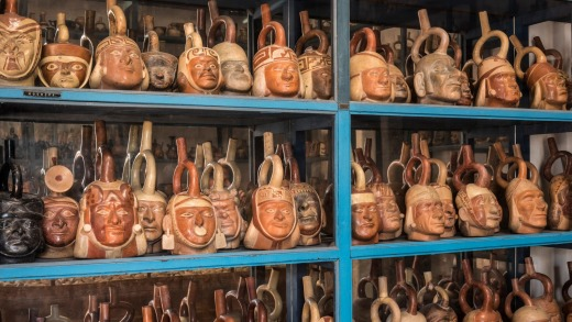 Huaco pottery vessels of the pre-Columbian Mochica (aka Moche) culture in the Museo Larco in Lima. The faces are ...