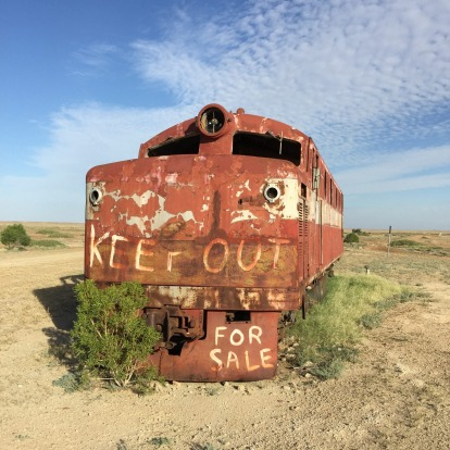 Last train: derelict Ghan loco for sale in the town of Marree.