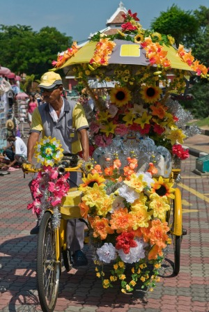 A garishly decorated rickshaw in Town Square, Malacca.