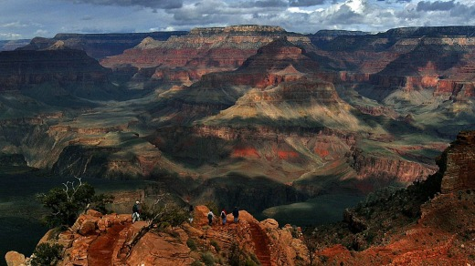 With the North Rim in the background, tourists hike along the South Rim of the Grand Canyon.