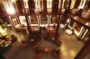 HERITAGE SUITES: Behind the colonial-era facade, intimate balcony dining overlooks a bar and lounge of dark woods and ...
