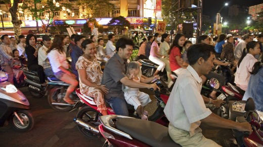 Not for the faint-hearted: Scooters at night, Ho Chi Minh City, Vietnam.
