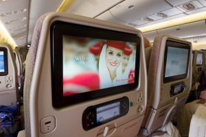 Entertainment system screens inside the cabin of a Emirates Boeing 777.