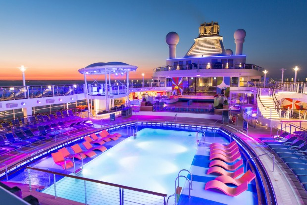 Anthem of the Seas' pool deck at sunset.