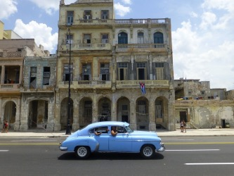Strolling along the Malecon -Havana's seafront boulevard - I captured this image which encapsulates much of the feeling of old Havana. The faded glory of the architecture and 50's American cars have a distinctive charm that is all Cuban. The flag seems to add the finishing touch.
