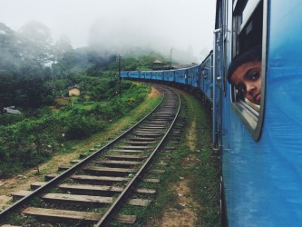 It's hard to get anywhere fast on the delightfully rambling trains in Sri Lanka but when the trail winds through breathtaking hills, tea plantations and villages; you've topped up on samosas at the last platform; the wind is in your hair and you're in third class where everyone is friends, the journey really is as good as the destination. (Taken April 2015 between Ella and Kandy, Sri Lanka)