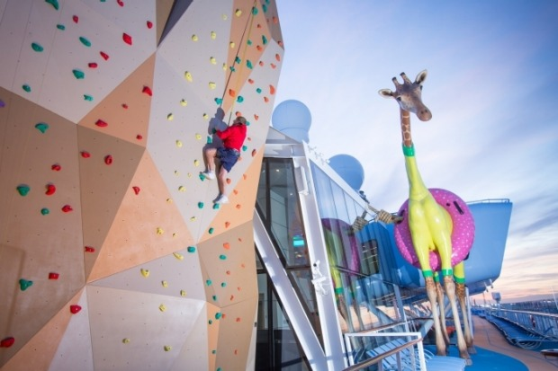 Gigi the Giraffe and the climbing wall on board Anthem of the Seas