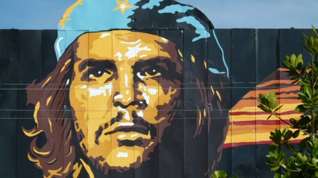 A portrait in Havana of Che Guevara, one of the world's most famous travellers.